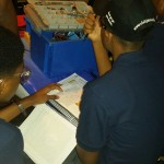 Jamaica College Robotic Team Making slight adjustments to the Engineering Notebook